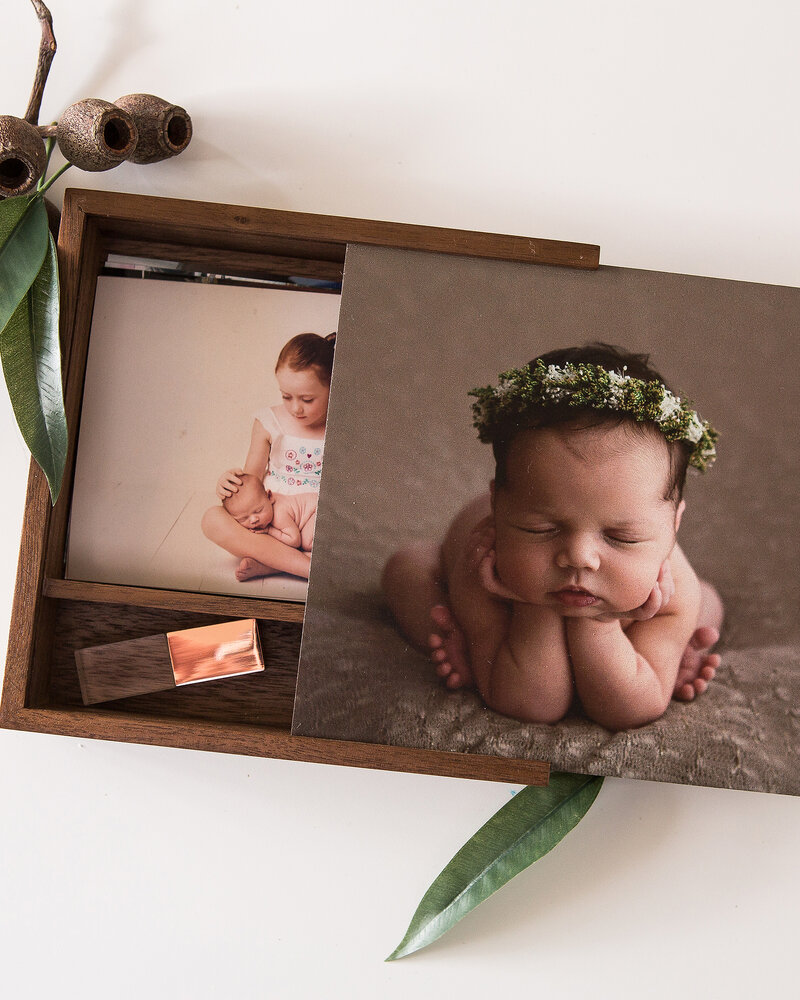 Wooden photo box with professional newborn prints and USB