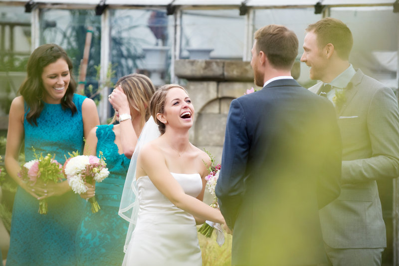 a couple laughs during their wedding vows at castaway portland