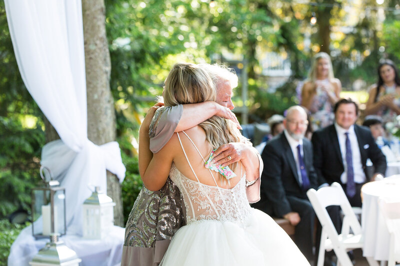 mother hugging bride
