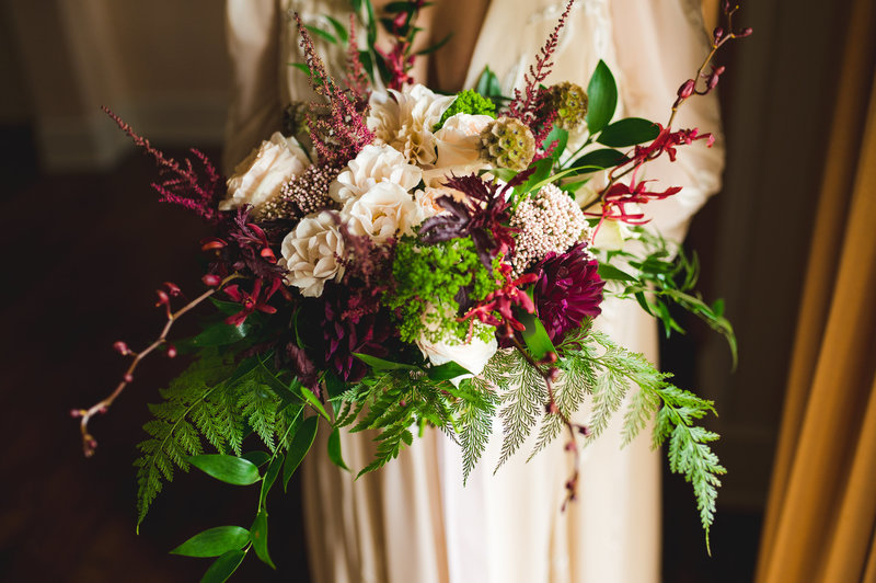 Bride with burgundy and blush garden style bouquet