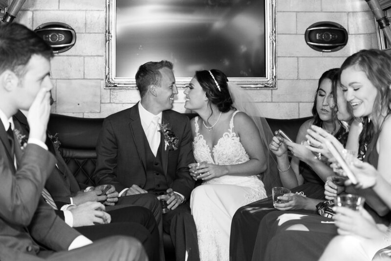 groom and bride kiss on party bus