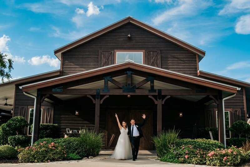 Bride and groom celebrating at their College Station wedding venue. Peach Creek Ranch