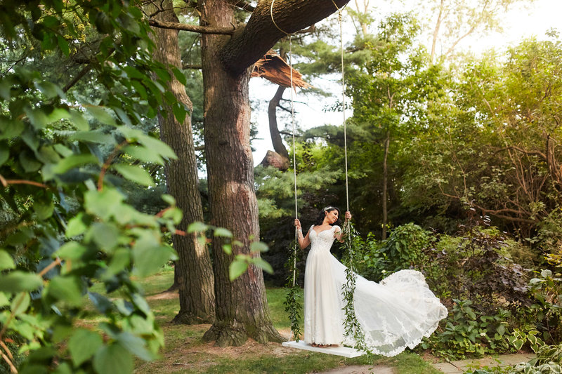 bride on swing from tree