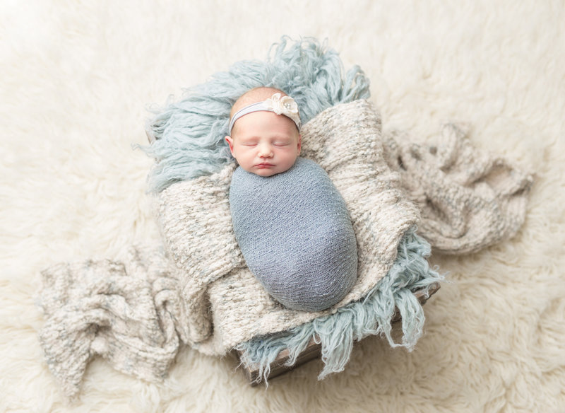 Bbay girl wrapped in grey and blue posed studio