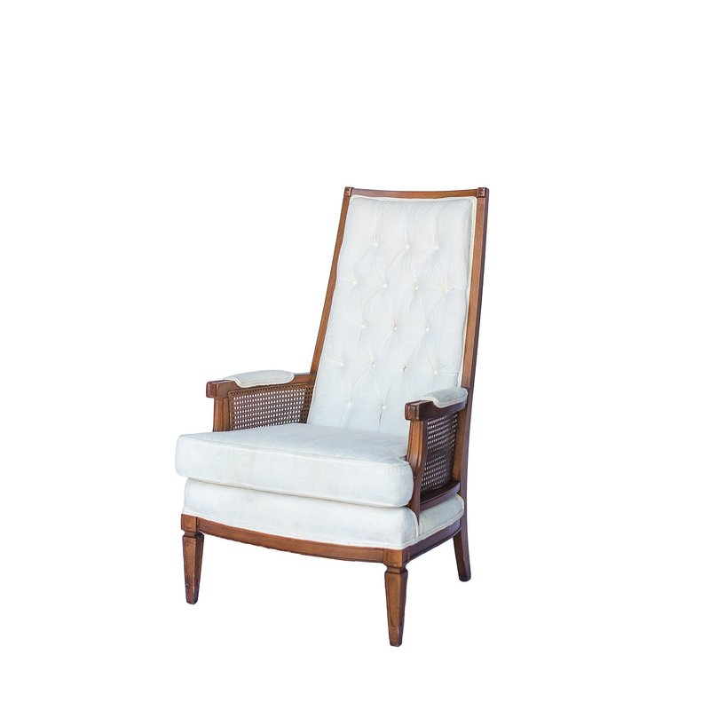 Vintage cream upholstered tall back chairs.