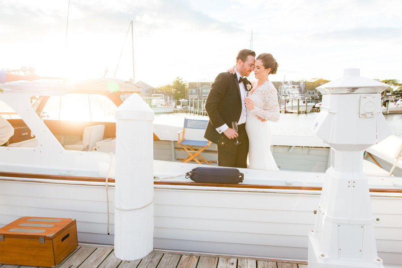 Sunset photo of bride and groom on boat