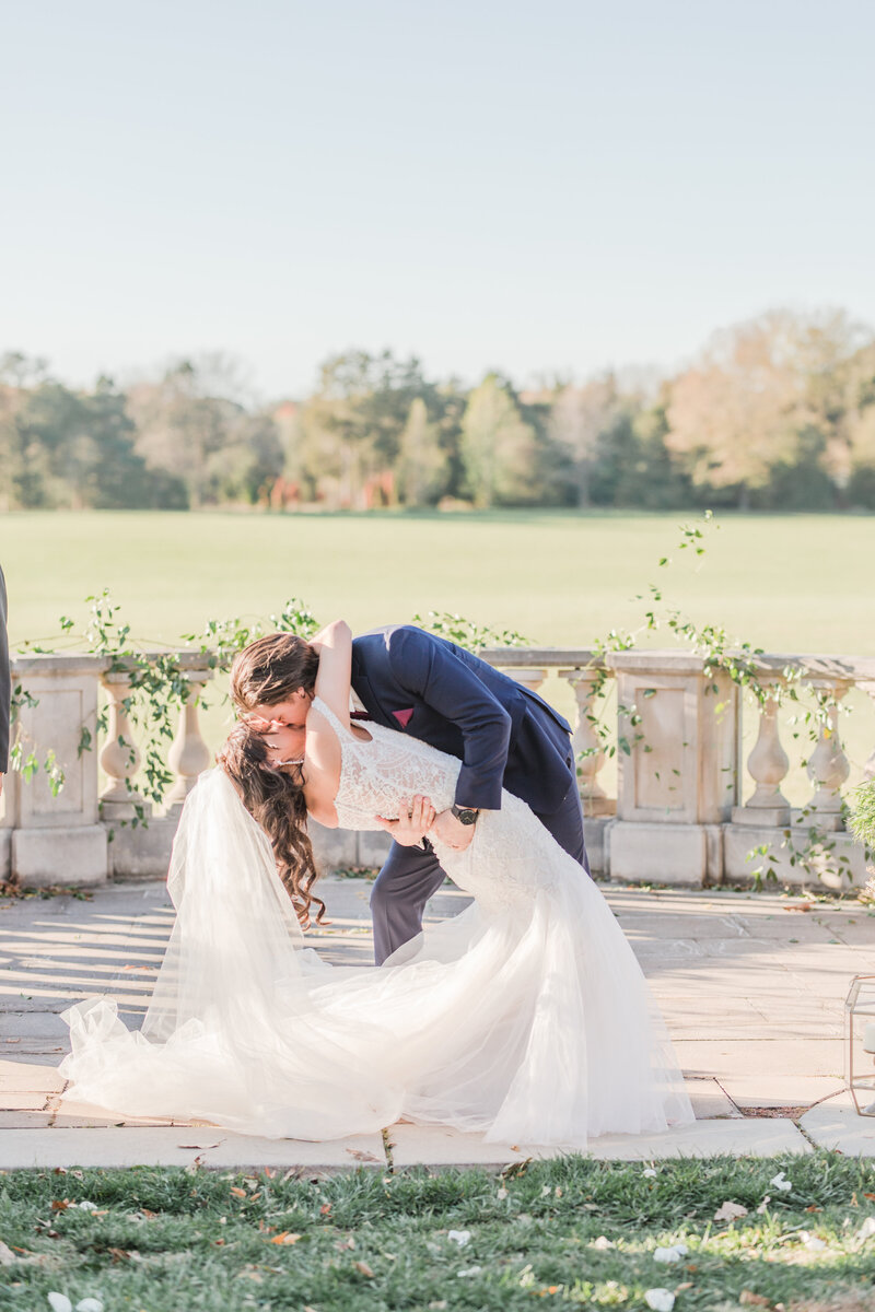 bride and groom first kiss at ceremony at great marsh estate wedding in charlottesville virginia by costola photography