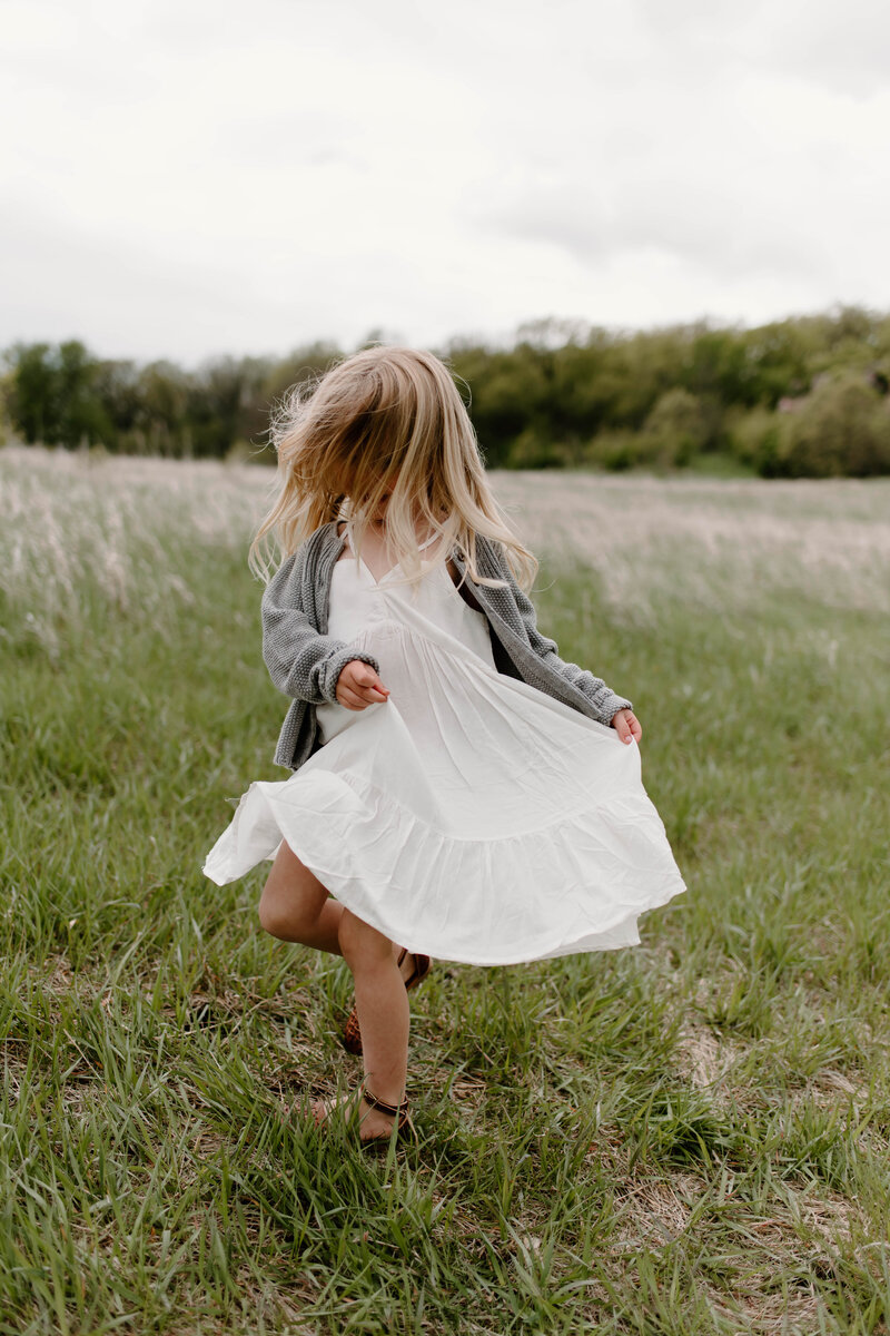 little girl running on the grass