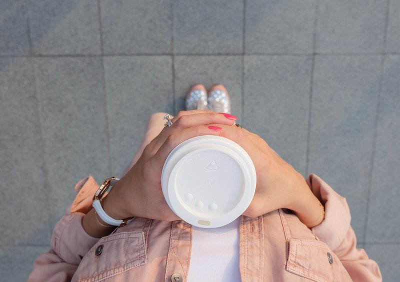 person-holding-white-disposable-cup-999305