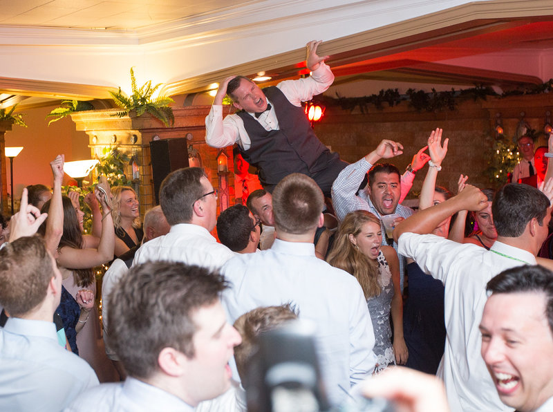 Guest crowdsurfs at Masonic Temple wedding reception