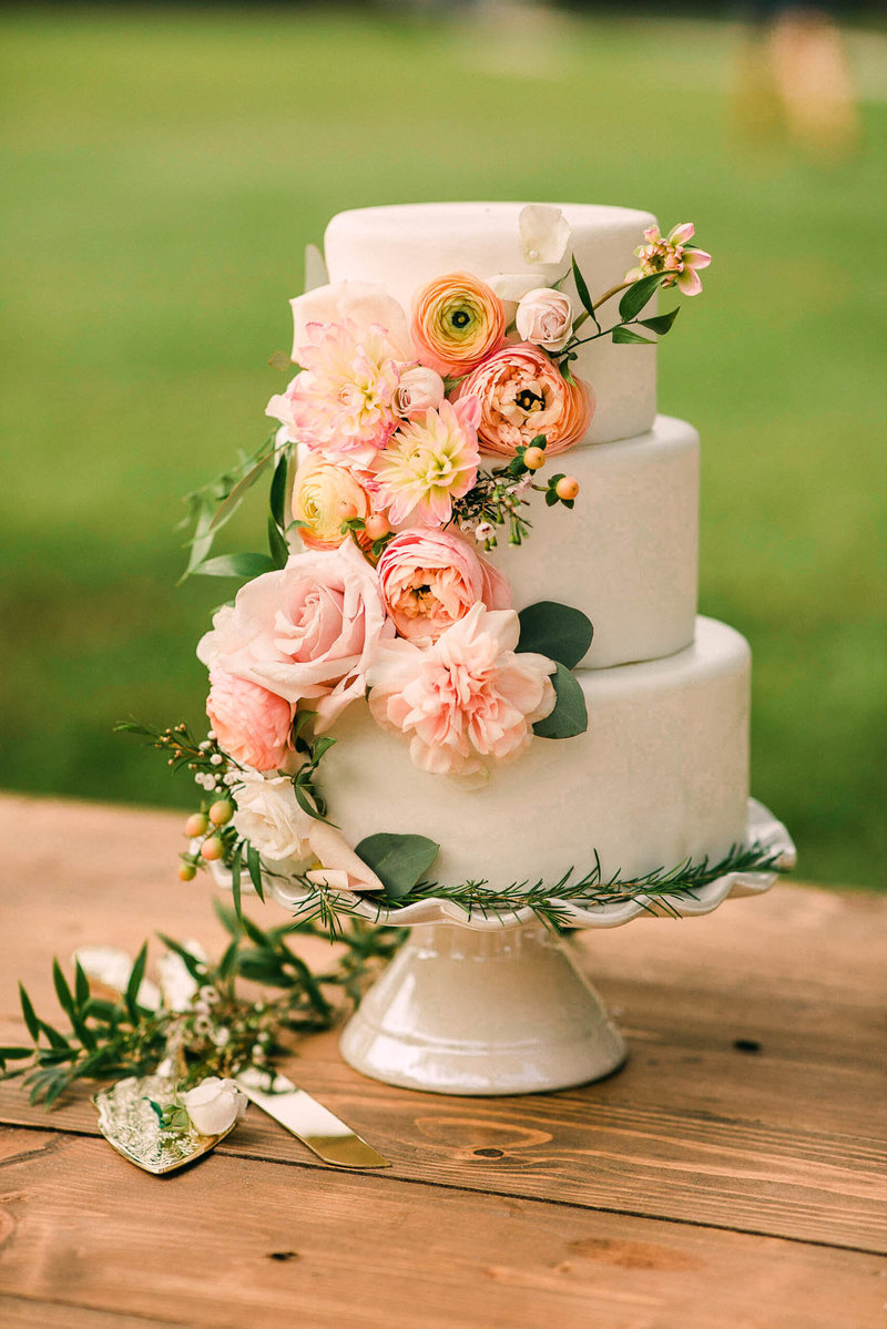 Peach floral wedding cake at the Edison