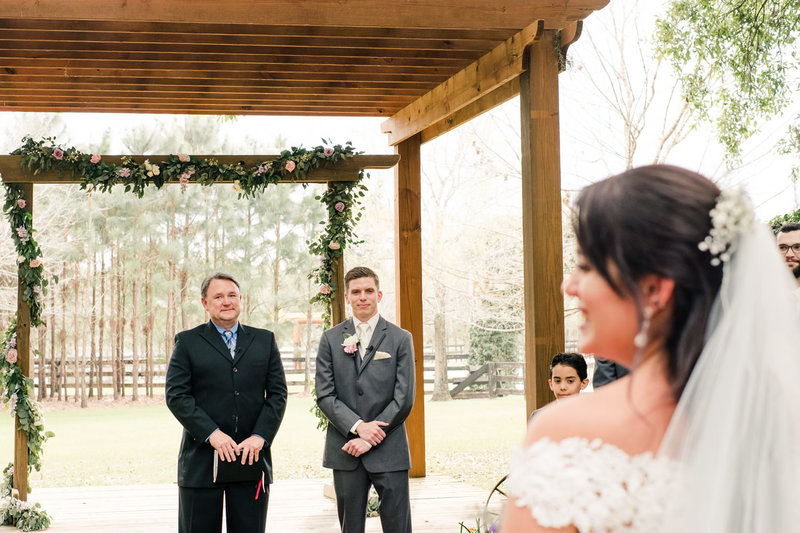 Groom sees his bride for the first time at Club Lake Plantation Wedding