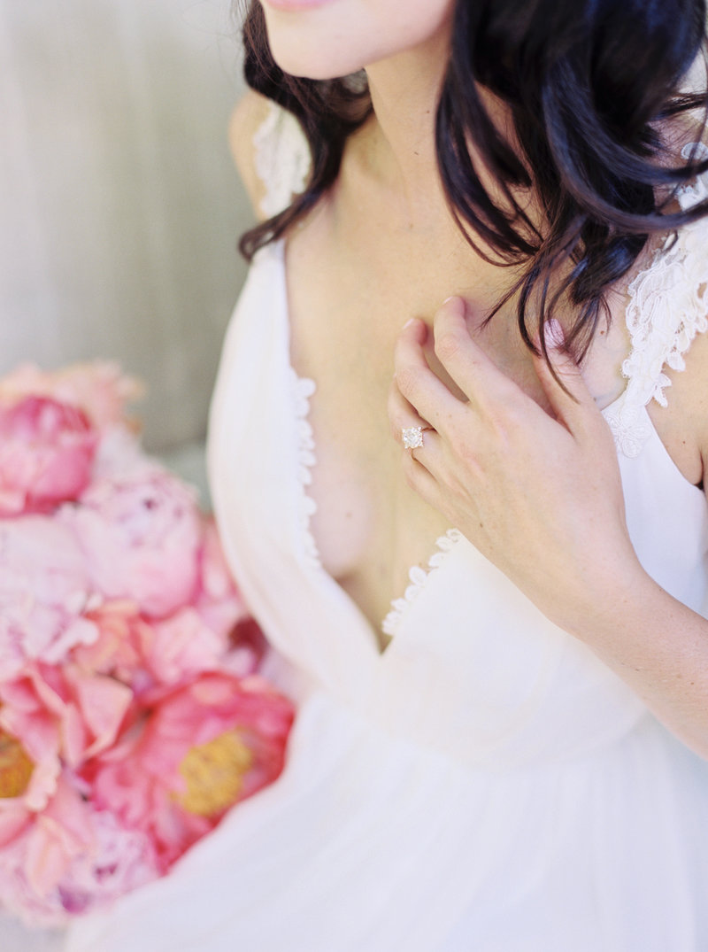 Bride with flowers and engagement ring