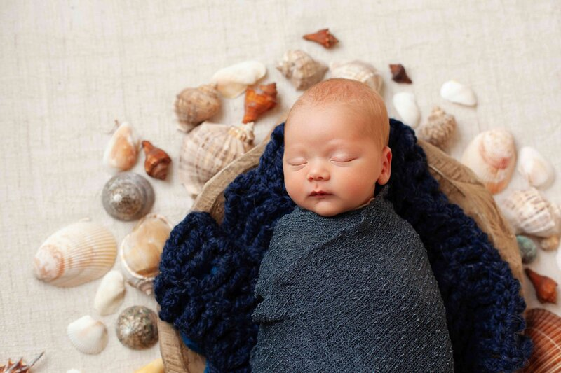 Newborn boy blue wrap sea shells