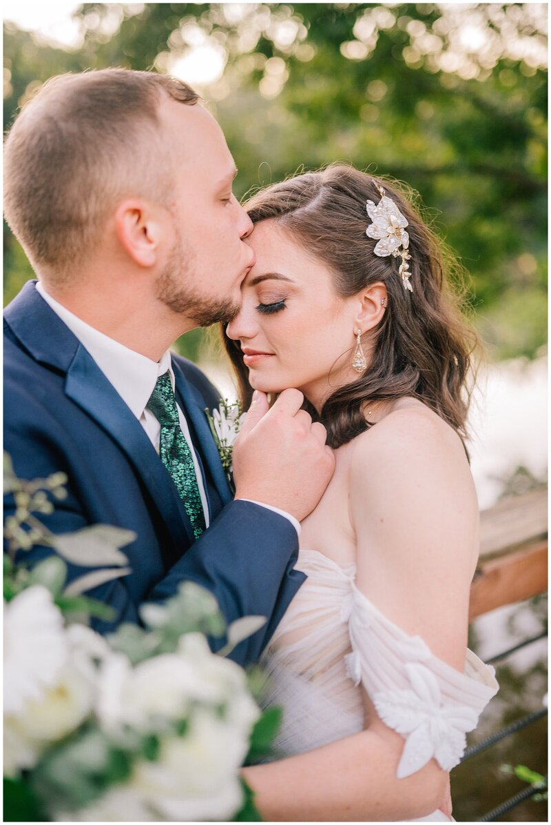 Knoxville Wedding Photographer | groom hugging bride by lake in Chattanooga Tennessee