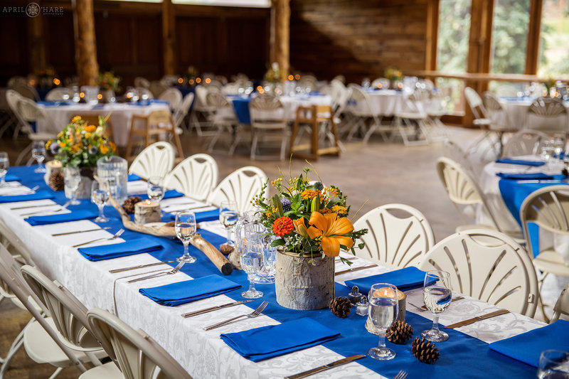 Orange and blue wedding decor for a rustic barn wedding in Colorado