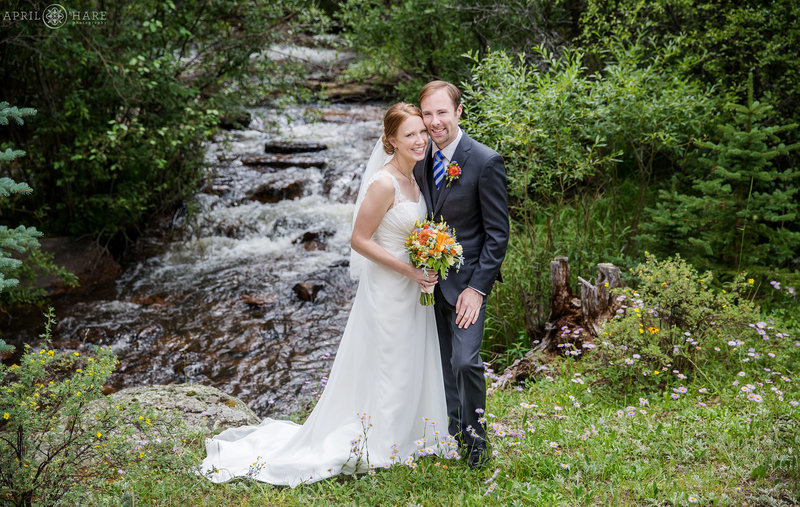 Beautiful couples portrait in front of Elk Creek at Mountain View Ranch in Colorado