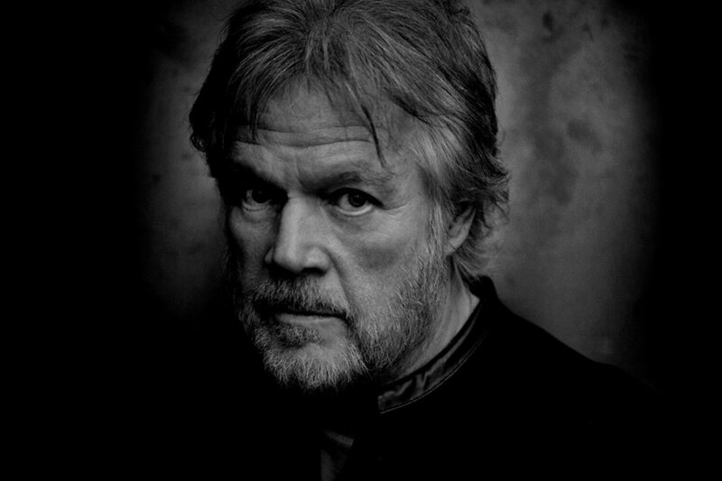 Randy Bachman black and white portrait closeup against dark background