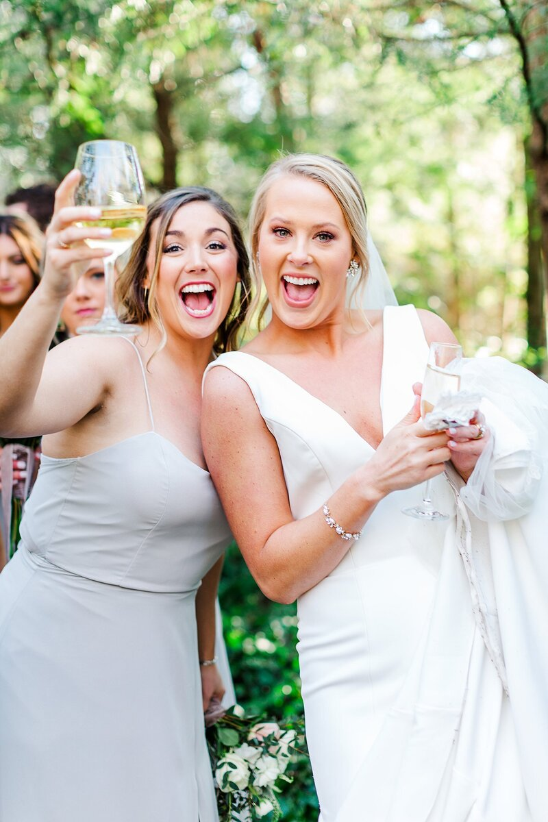 bride and bridesmaid celebrating by Knoxville Wedding Photographer, Amanda May Photos