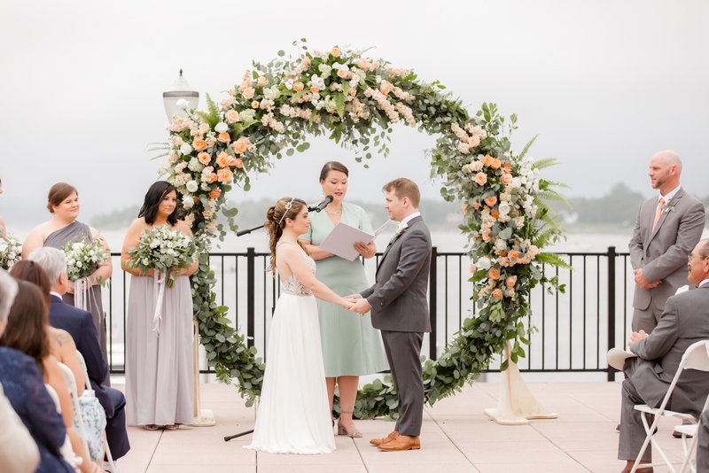Wedding ceremony with giant floral wreath