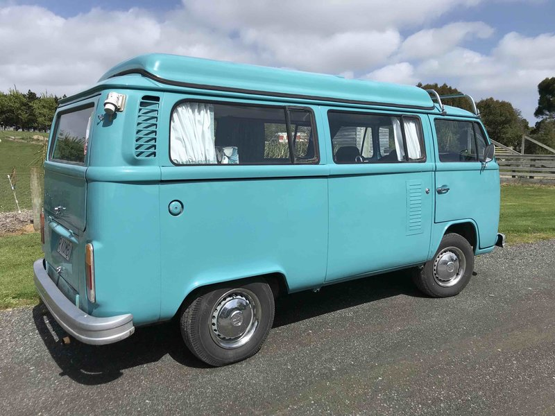 Right hand side on view of Rhonda, teal retro kombi van from NZ Kombi Hire