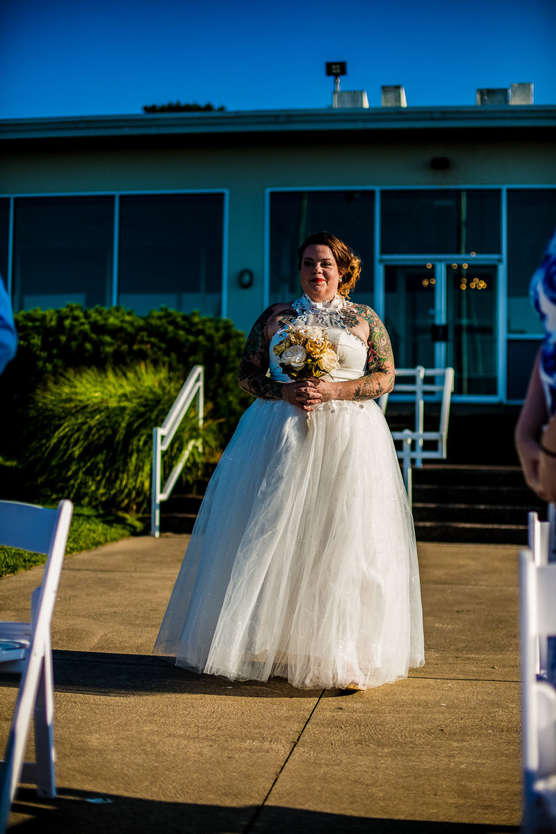 Bride processing to ceremony site at the Erie Yacht Club