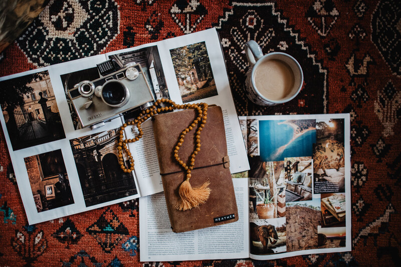 journal and picture laying on rug