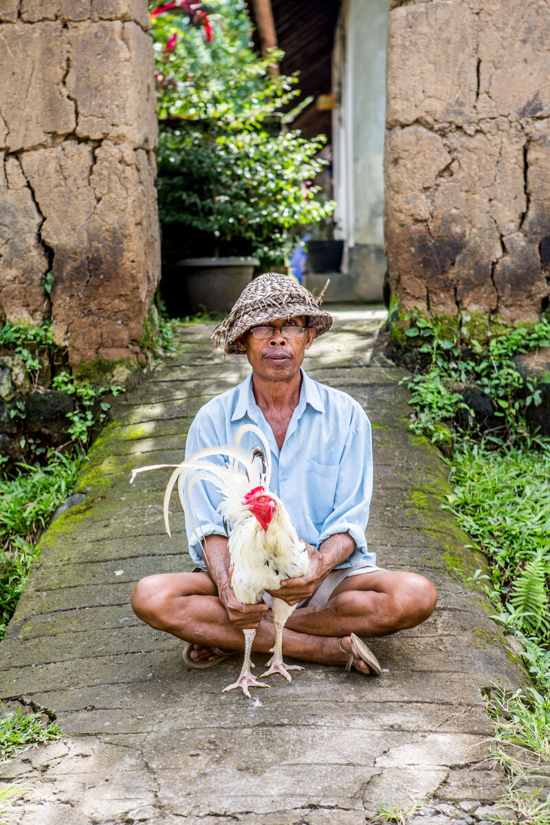Balinese man with his rooster
