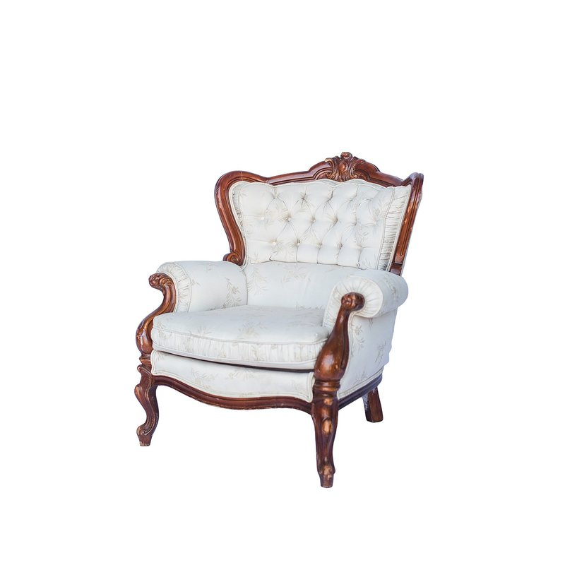 Plush ivory chairs with tufted back and dark wood trim.