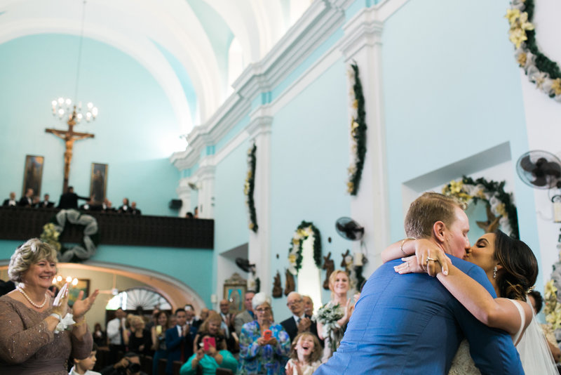 Bride and groom first kiss in Parroquia San Francisco de Asis