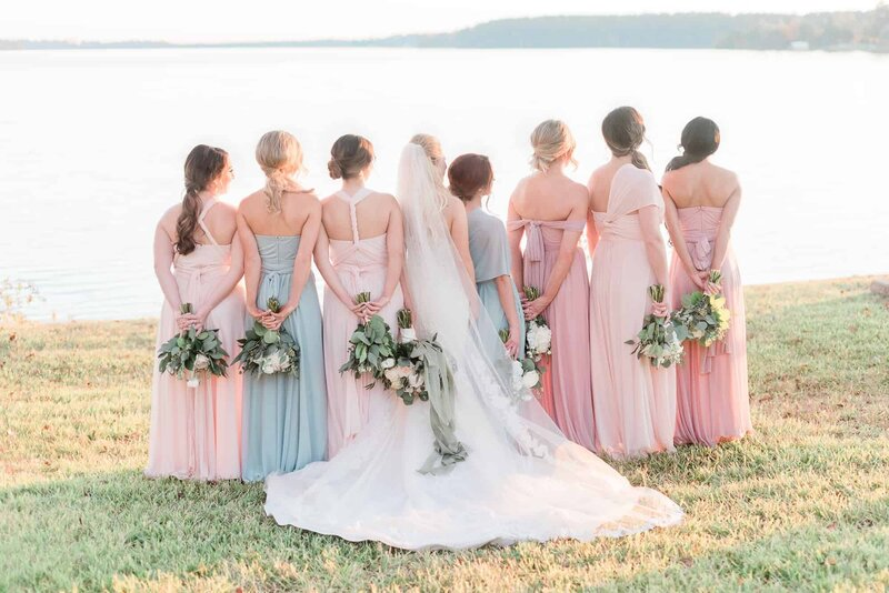 Dallas bride and bridesmaids overlooking lake