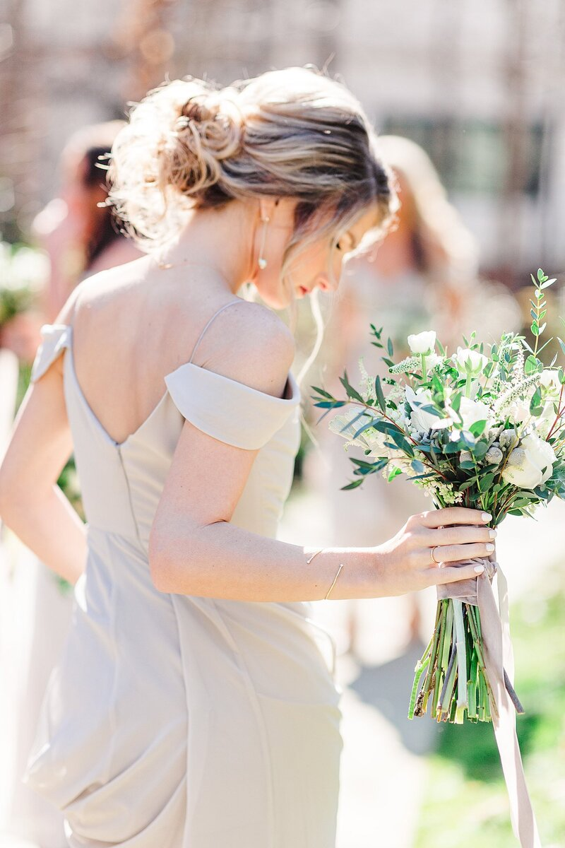 bridesmaid holding bouquet by Knoxville Wedding Photographer, Amanda May Photos