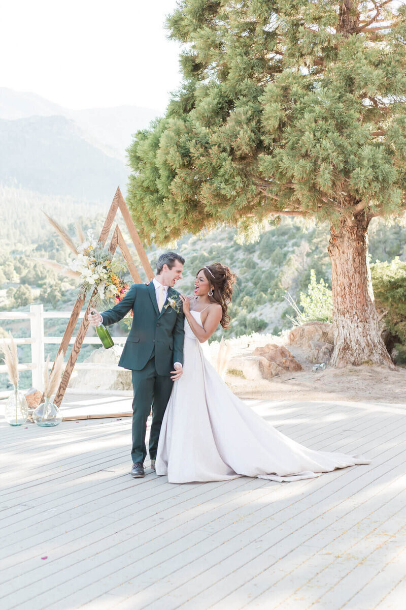 Bride and Groom popping champagne Mount Charleston Wedding