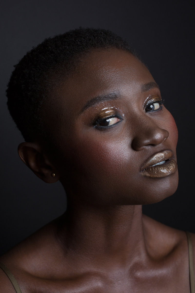 gold makeup on dark skin beauty editorial