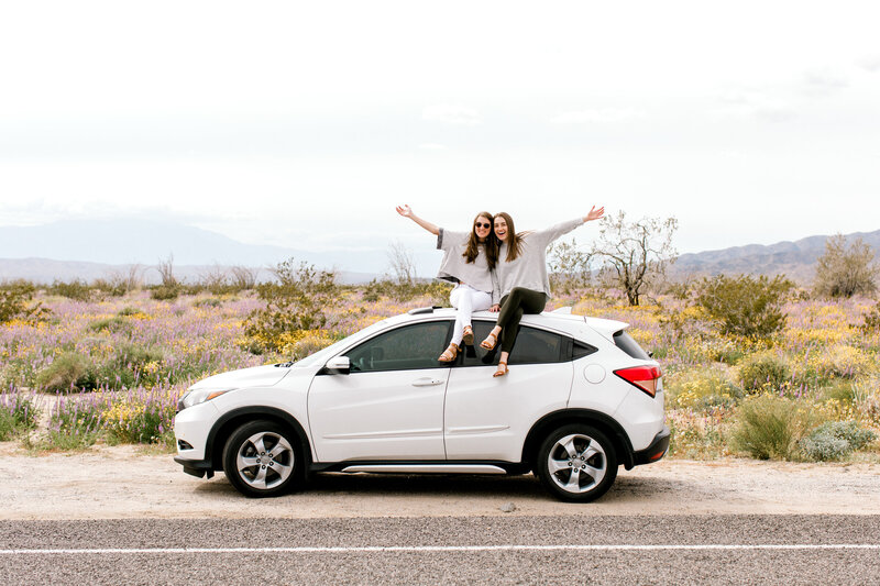 girls on top of car at Joshua Tree National Park
