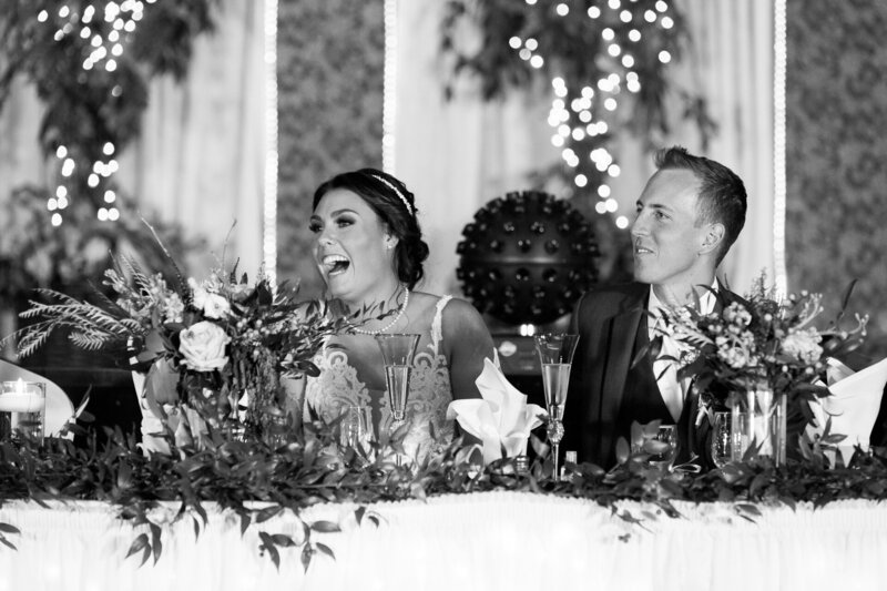 bride and groom laugh at detroit wedding reception