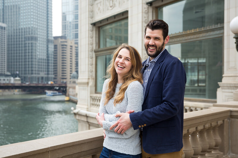 couple laughing by wrigley building downtown chicago