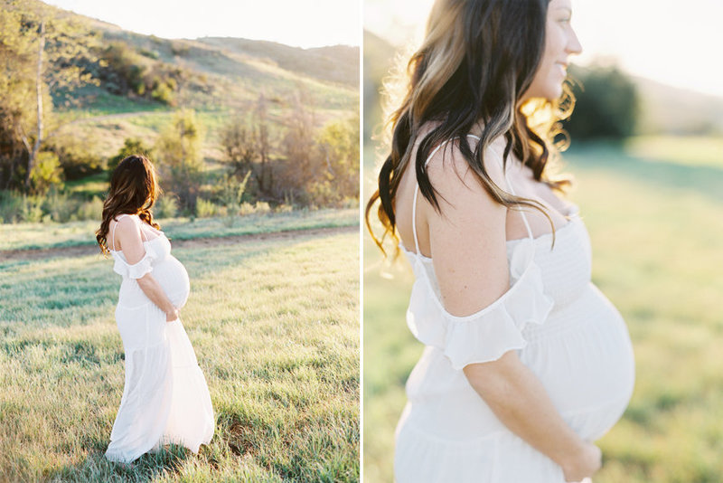An expectant mother wearing a white dress walks through a field in golden afternoon light in Thousand Oaks, Ca