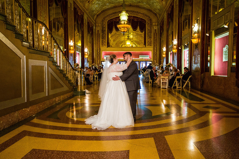 Bride and groom dance at the Warner Theatre in Downtown Erie, PA