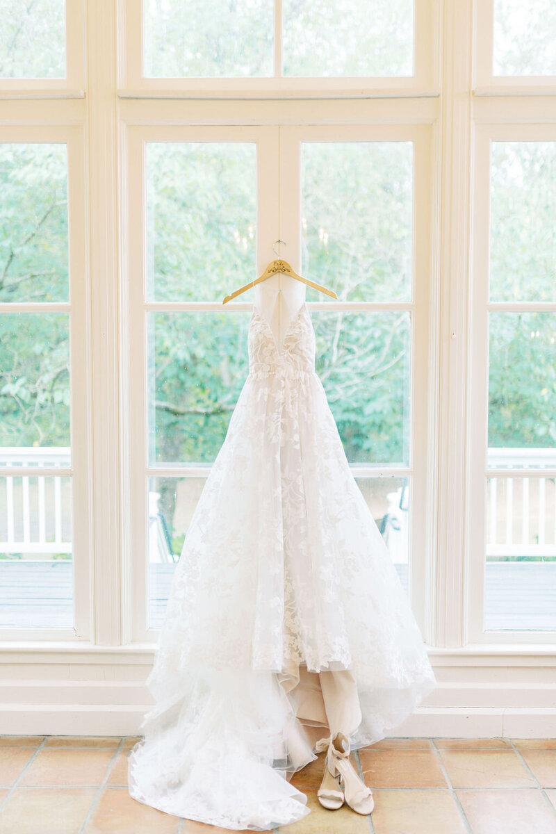 Wedding dress hanging on a door