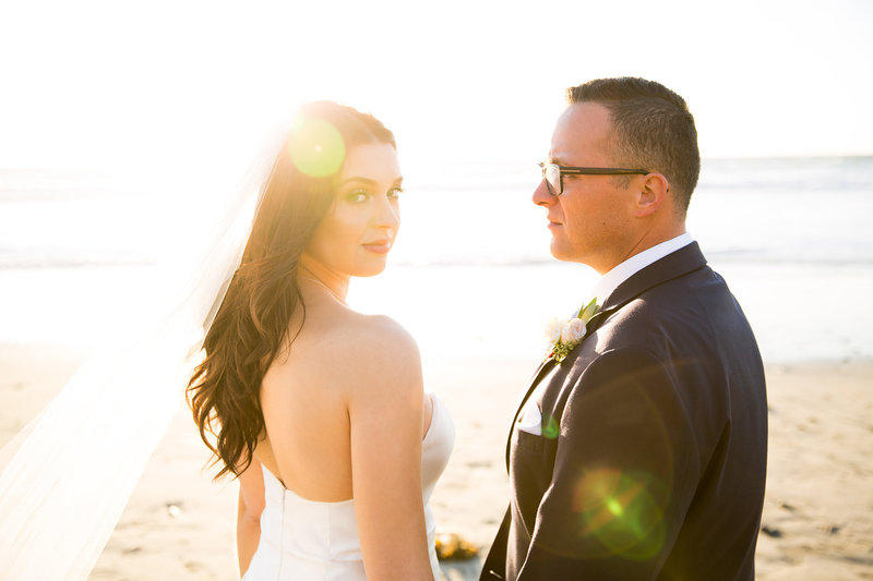 Bride and Groom in Cool Lens Flare Sunset Photo at Del Mar