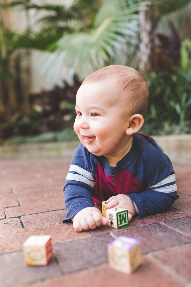 baby playing with blocks conservatory ohio
