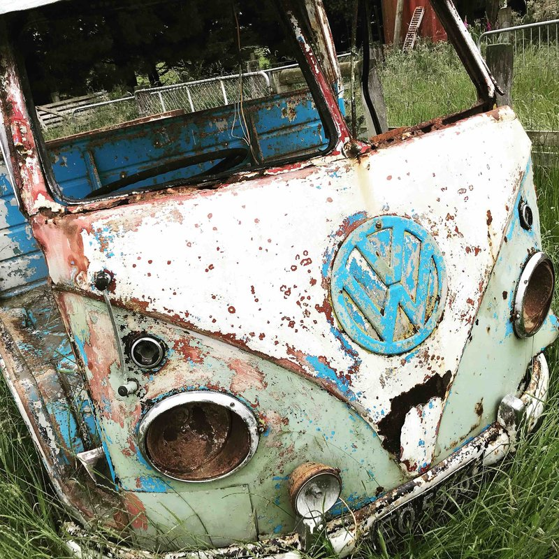 Old remains of a split screen kombi van in paddock, Southland, New Zealand