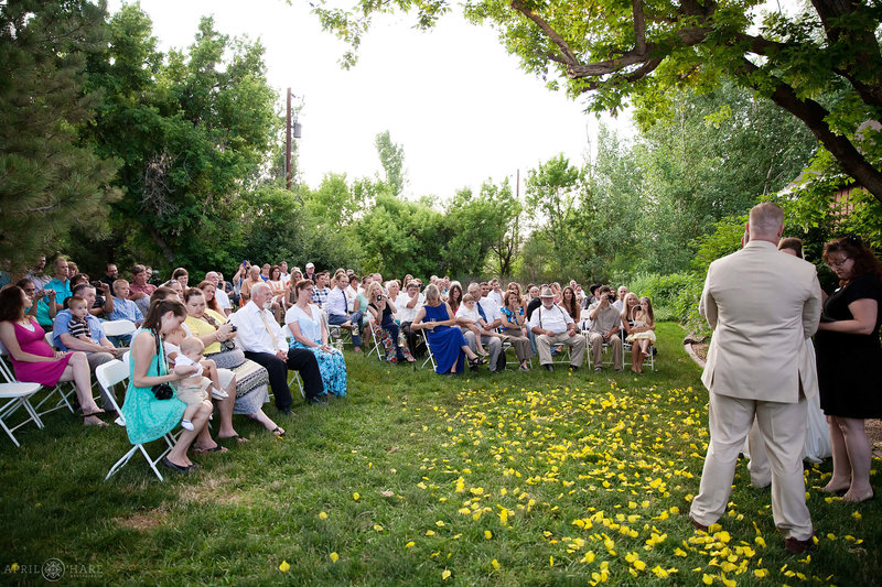 Wedding guests on the lawn next to barn at Chatfield Farms Denver Botanic Gardens
