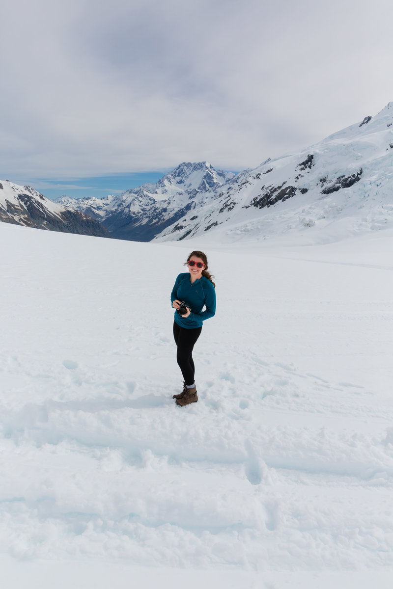 Clarissa Wylde photographing adventures on a glacier in New Zealand.