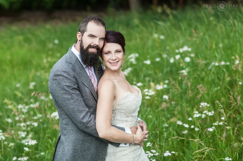 Summer wedding with wildflowers in the mountain meadow at The Pines at Genesee