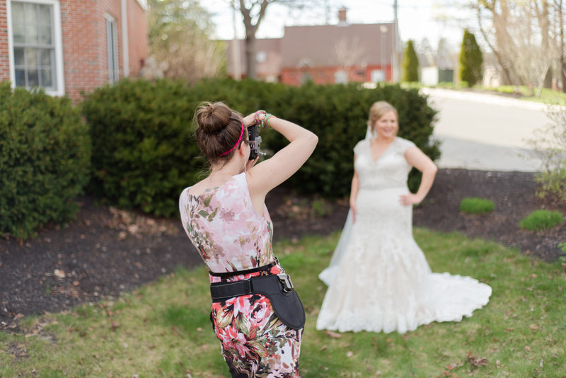 Linda barry taking photos of a bride on her wedding day in Brunswick!