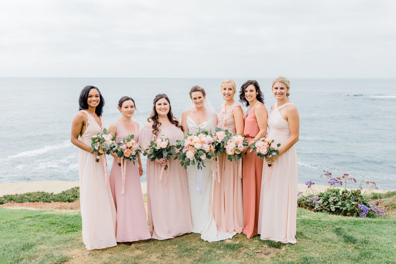 bridal party in pastel colored gowns