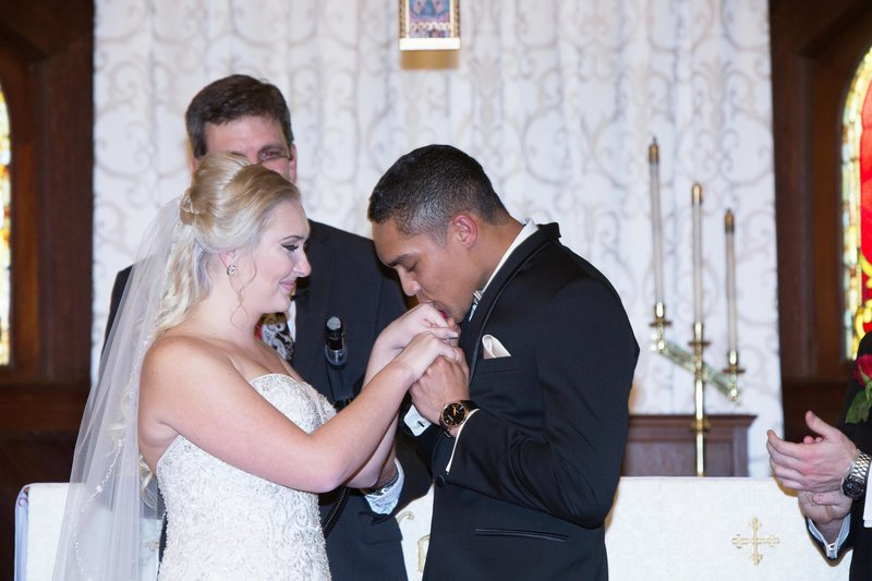 groom kissing brides hand, wedding ceremony, episcopal church wedding