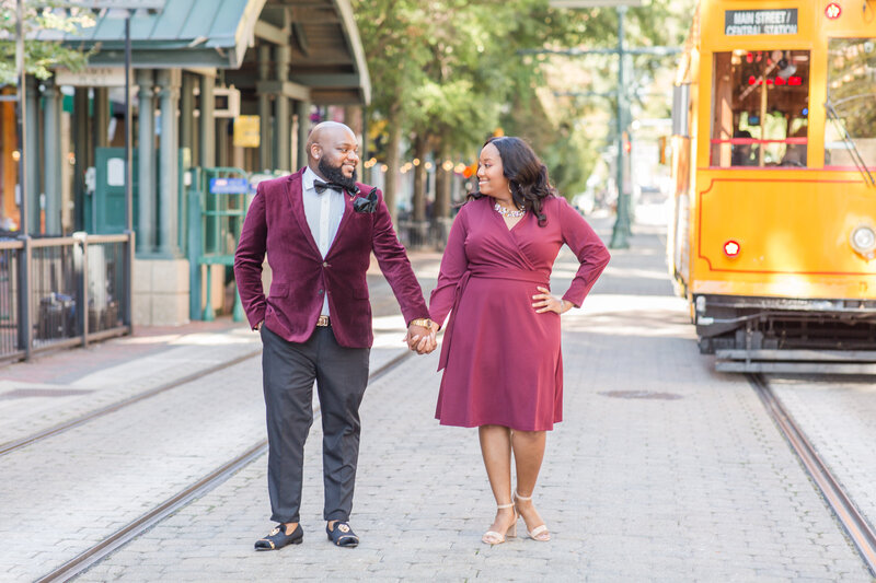 bride and groom smiling at each other during their engagement session in downtown memphis